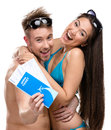 Half length portrait of half naked couple with travel tickets isolated on white concept romantic vacations and lovely honeymoon Stock Image