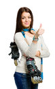 Half length portrait of teen holding roller skates teenager handing and wearing colored scarf who thumbs up isolated on white Stock Photography