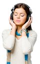 Half length portrait of teen listening to music teenager with eyes closed in earphones isolated on white Royalty Free Stock Photos