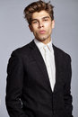 Half-length portrait of young handsome man in suit Royalty Free Stock Photo