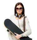 Half length portrait of youngster with skateboard teenager wearing sunglasses earphones and handbag isolated on white concept Stock Images