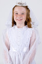 Half length shot young girl smiling her first communion dress veil Stock Photos