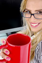 Half length view of female offering coffee Stock Photo