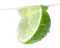 Half a lime green in bubbles isolated on white Stock Image