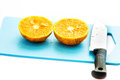 A half of orange fruit and knife in the kitchen Royalty Free Stock Images