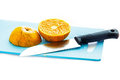 A half of orange fruit and knife in the kitchen Royalty Free Stock Photo