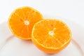 Half orange fruit on white background fresh and juicy Stock Image