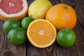 Half orange with other fruits on wood fresh citrus old Royalty Free Stock Photography