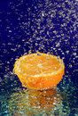 Half of orange with stopped motion water drops Royalty Free Stock Images