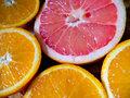 Half pink grapefruit and orange Royalty Free Stock Photo