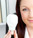 Half portrait of a businesswoman with light bulb Royalty Free Stock Photos