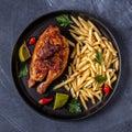 Half Roasted Chicken Piri Piri with French Fries Royalty Free Stock Photo