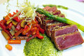 Half-roasted tuna with stewed vegetables Royalty Free Stock Images