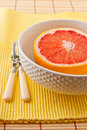 Half of ruby red grapefruit in a bowl ready to eat Royalty Free Stock Photo