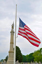 Half staff flag at a burial ground Stock Photography