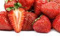 Half of strawberries on the background of berries Royalty Free Stock Photography