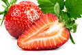 Half and a strawberry with a sheet isolated closeup Stock Image