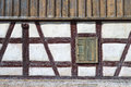 Half-timbered facade with window shutter