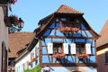 Half timbered house in alsace typical to eguisheim village of Stock Images