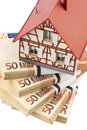 Half timbered house on euro banknotes symbolic photo for home purchase financing building society Royalty Free Stock Photo