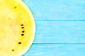 Half yellow watermelon of on a wooden background top view Royalty Free Stock Photo