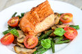 Halibut with asparagus and cherry tomatoes Royalty Free Stock Photo
