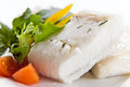 Halibut with greens and vegetables Royalty Free Stock Photos