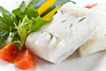 Halibut with greens and vegetables Stock Image