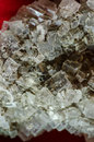 Halite rock salt closeup on red fabric Stock Photos