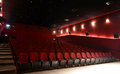Hall of a cinema red lines red seats Stock Photo