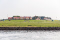 Hallig hooge restaurant and dwellings on the warft on the in north friesland on may the is located in the wadden sea in the Royalty Free Stock Images