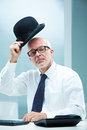 Hallo sir hallo madam elegant english businessman with square glasses greeting with his bowler Stock Photo