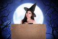 Halloween asian witch holding parchment paper Royalty Free Stock Photo
