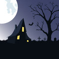 Halloween  background with haunted house, tree  and cemetery Royalty Free Stock Photo