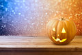 Halloween background with pumpkin jack lantern on wooden table Royalty Free Stock Photo