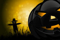 Halloween background with scarecrow and pumpkin in the grass Royalty Free Stock Images