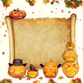 Halloween background scroll sign with foliage and carved orange pumpkins Royalty Free Stock Photography