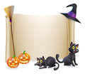 Halloween background scroll sign with witch hat broomstick carved orange pumpkins and witch s black cats Stock Images