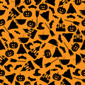 Halloween background seamless pattern black symbols on an orange Stock Photography