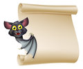 Halloween bat scroll an illustration of a cute cartoon vampire peeping round a sign and showing what is written on it Royalty Free Stock Photos