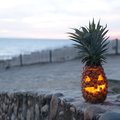 Halloween on beach tropical jack o lantern made out of pinapple Royalty Free Stock Photography