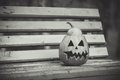 Halloween. black and white. pumpkin lies on a bench Royalty Free Stock Photo