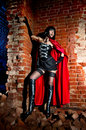 Halloween bloodthirsty vampire beautiful woman in the dungeon Royalty Free Stock Images