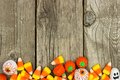 Halloween candy bottom border against rustic wood