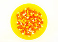 Halloween candy corn in colorful yellow bowl orange and a bright isolated on white Royalty Free Stock Photo