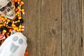 Halloween candy and decor side border over rustic wood