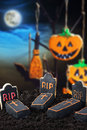 Halloween candy hanging on a tree in the night sky Royalty Free Stock Photos