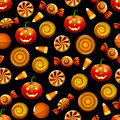 Halloween candy seamless pattern with pumpkins texture sweets corn and on black background Royalty Free Stock Image