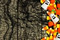 Halloween candy side border against spooky black background