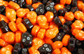 Halloween candy skulls orange and black skull candies Royalty Free Stock Images
